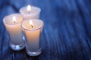 prayer candles on blue cloth
