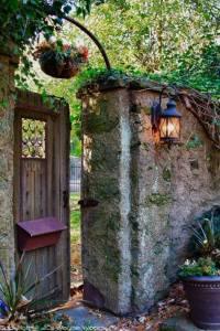 open gate in stone wall