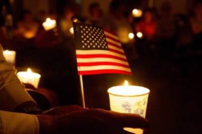 Veteran's day candle and flag