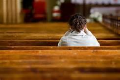 sit in pew, praying