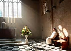 woman in prayer, sanctuary